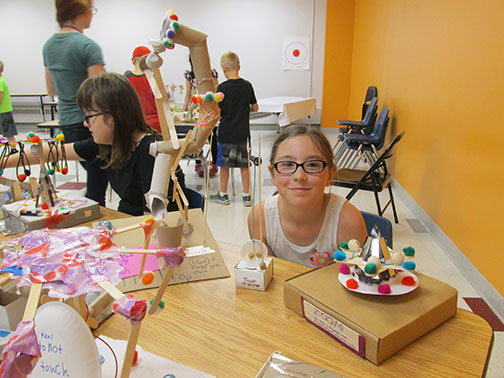 Kids explore with real tools and hands-on projects in The Works Museum's science and engineering summer camps in Minnesota.